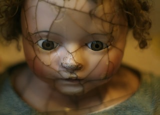 selective focus photography of porcelain doll