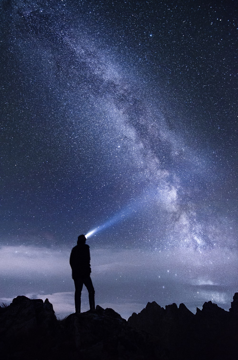 The milky way galaxy and a person's silhouette at nighttime in Kôprovský štít