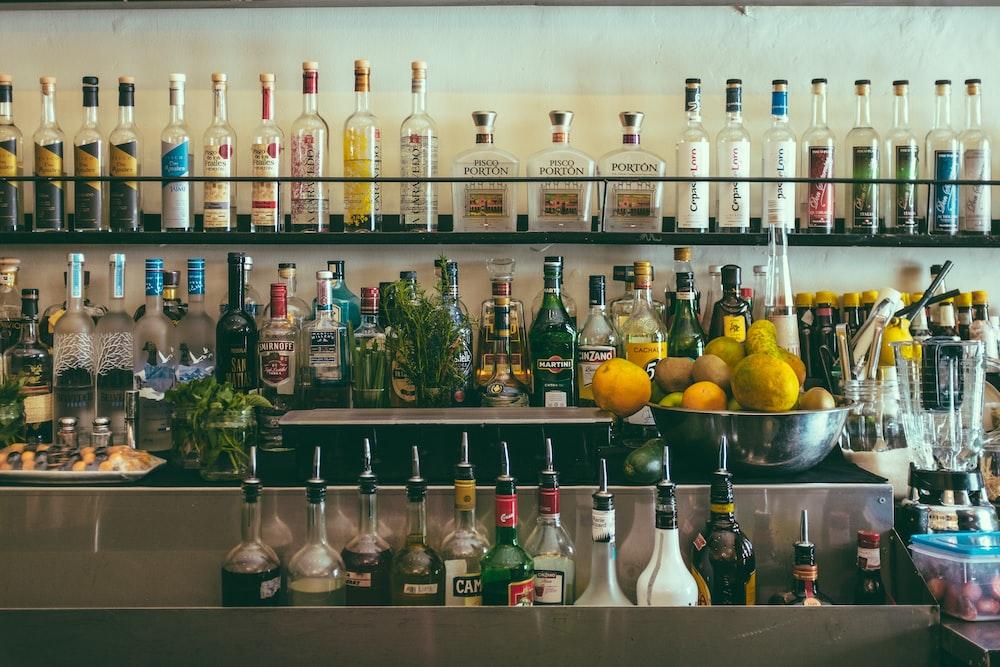 clear glass bottles on shelf
