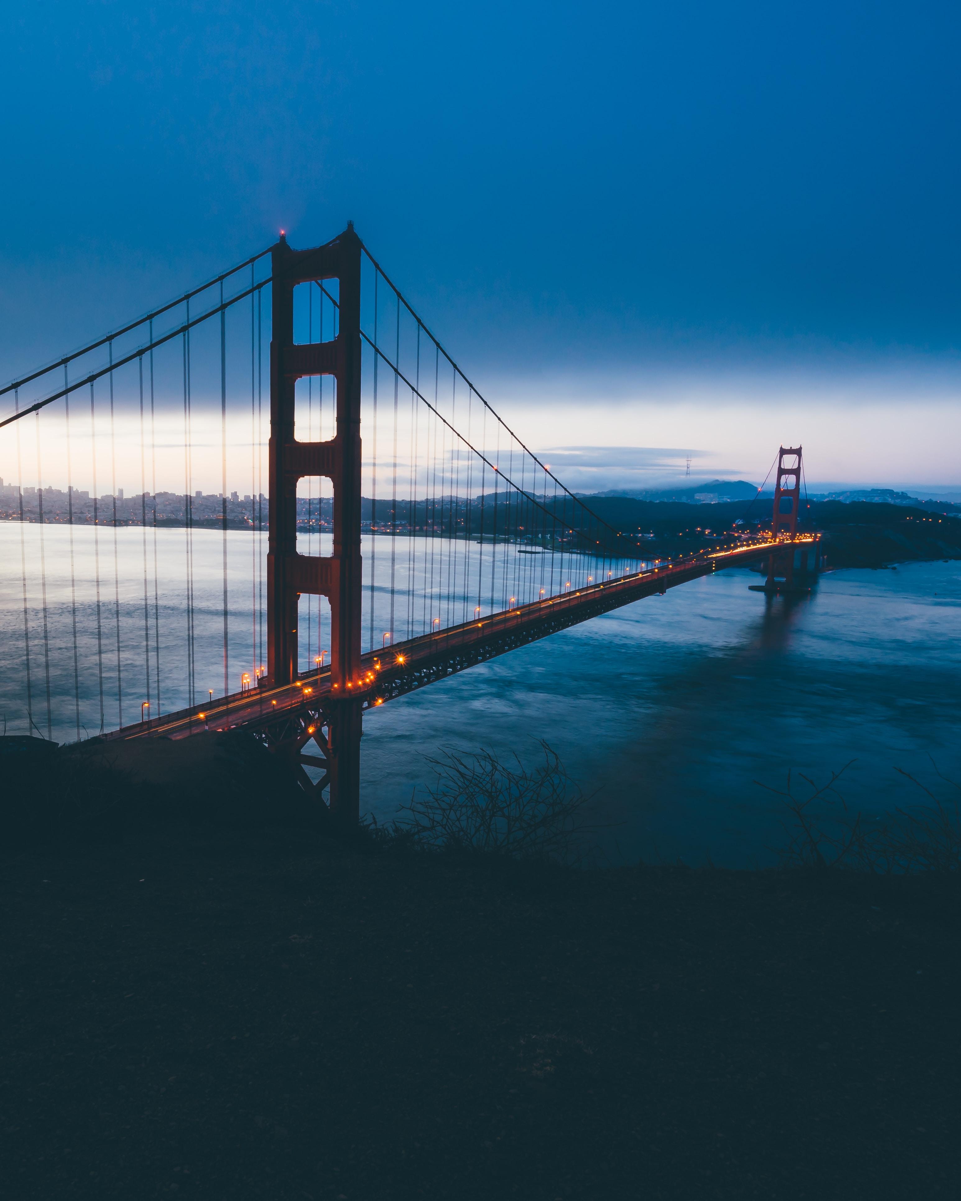 Glowing lights along the Golden Gate Bridge on an evening