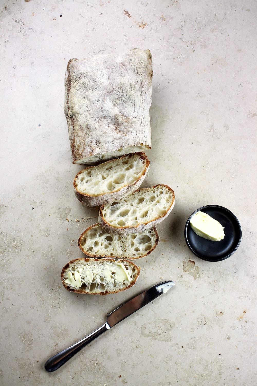 bread slices beside knife