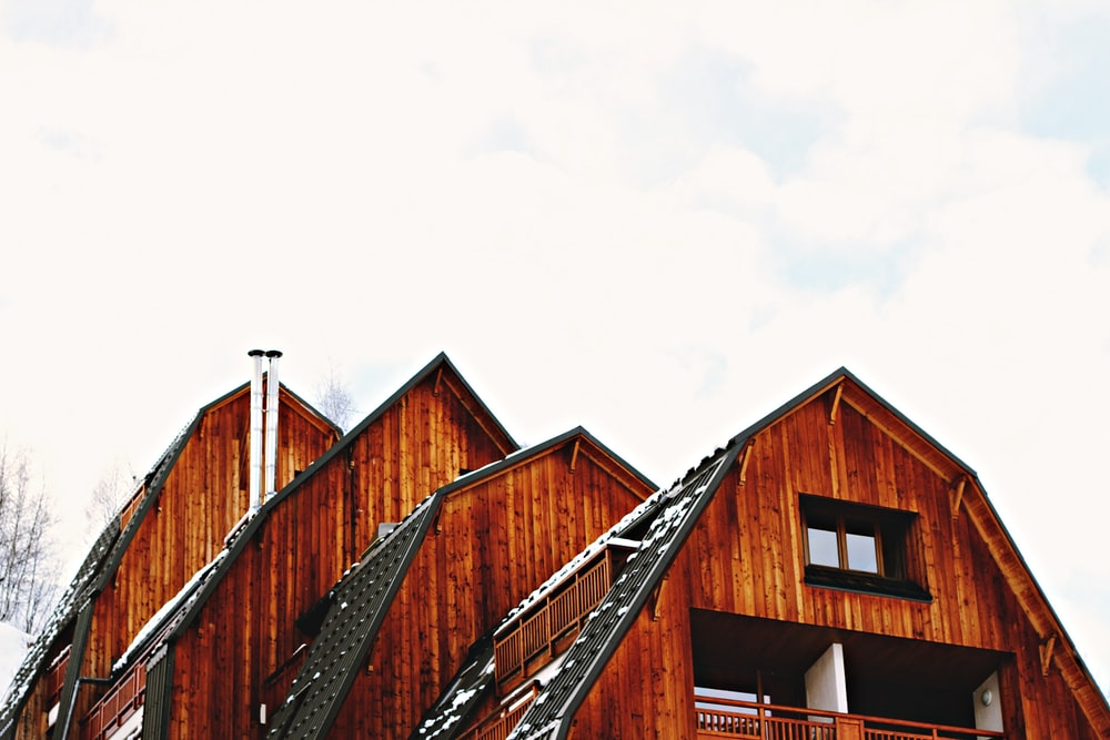 low angle photo of brown wooden house