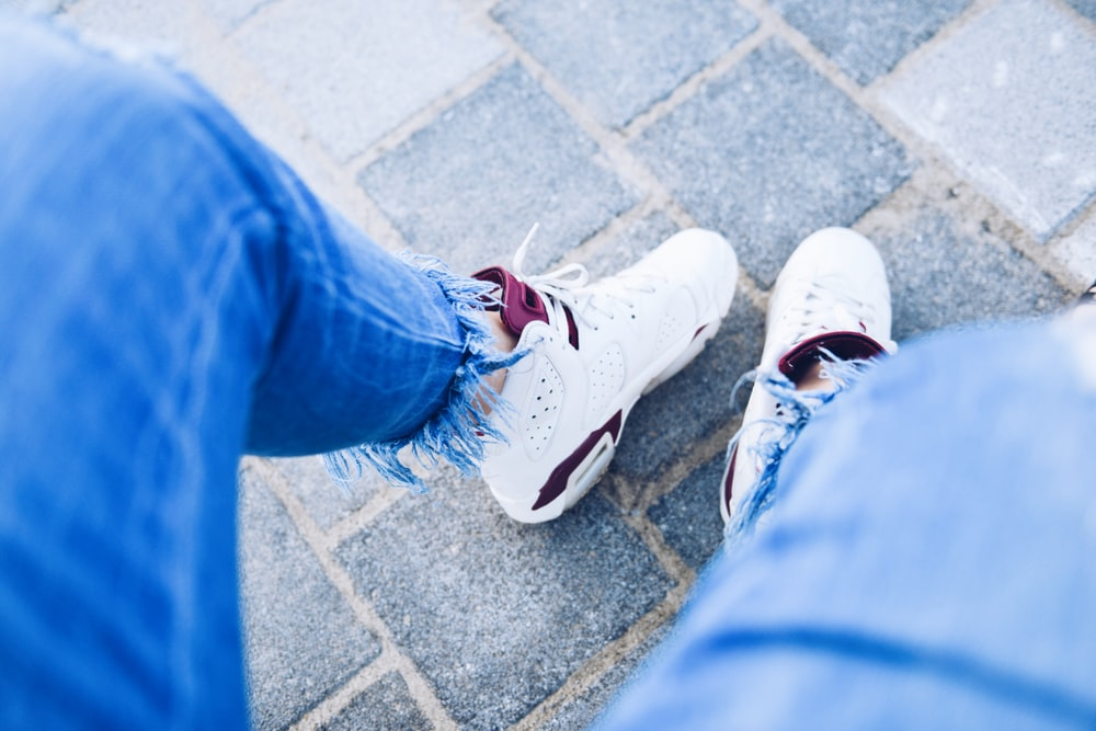 person wearing pair of white Air Jordan 6's
