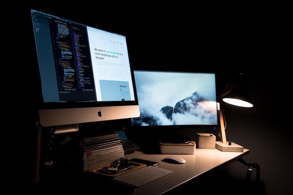 silver iMac turned on inside room