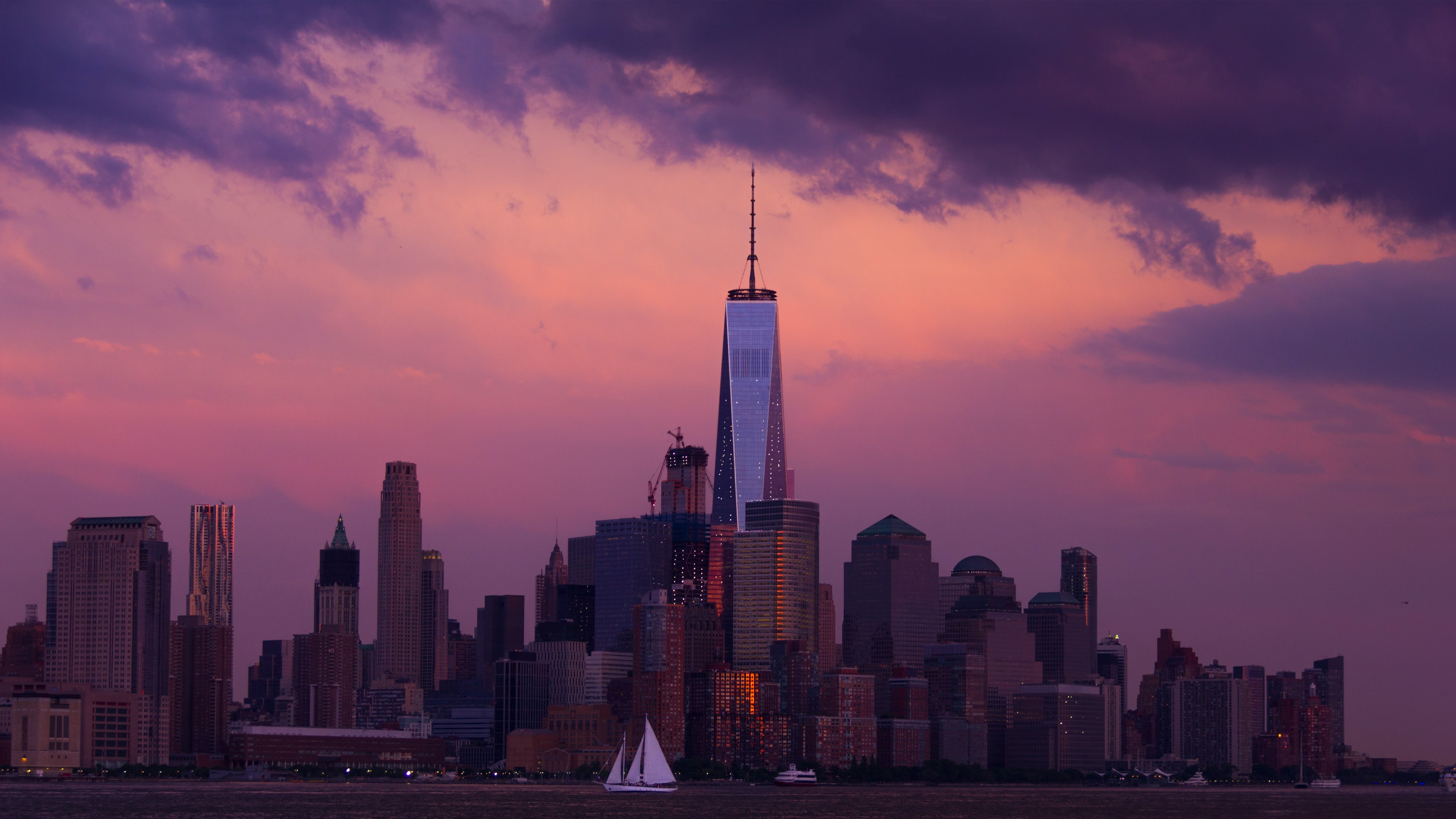 View of the New York City skyline with a beautiful pink and purple sunset