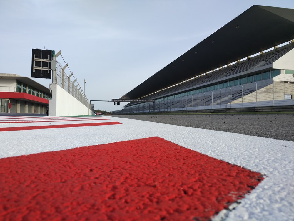 red and white race way near concrete building