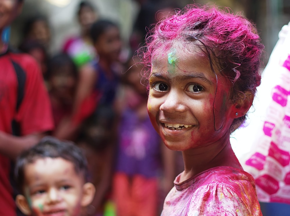 selective focus photo of girl in shirt smiling