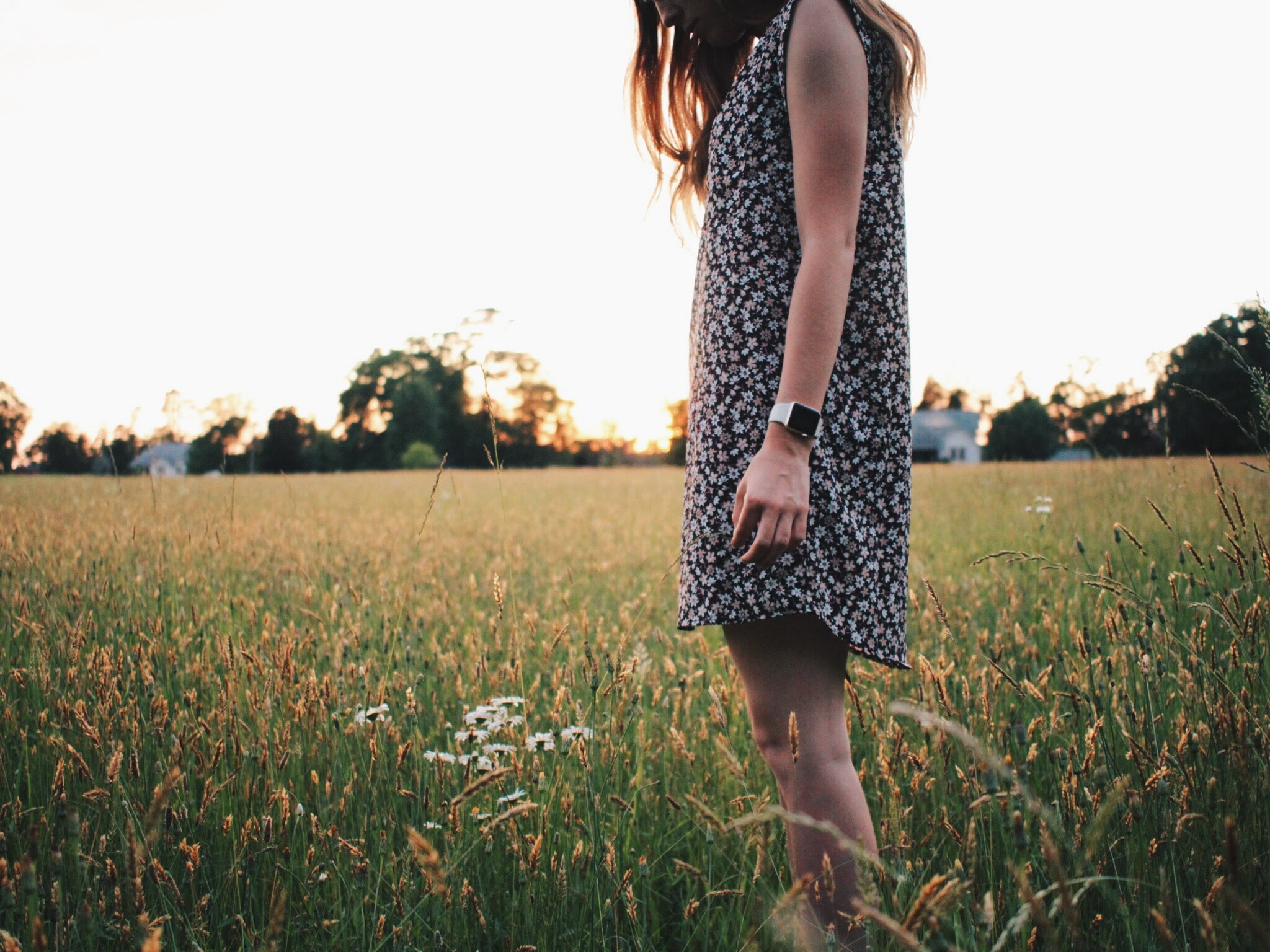 woman in black and white sleeveless dress on green grass field