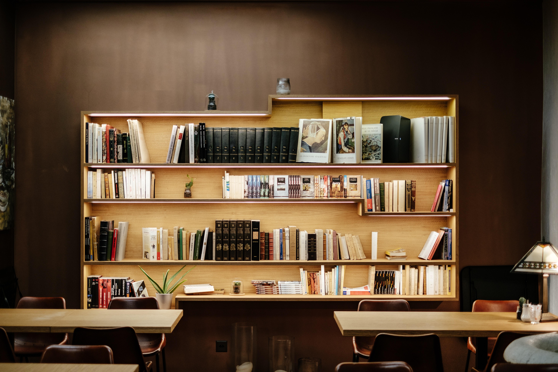 books filled wooden shelf inside room
