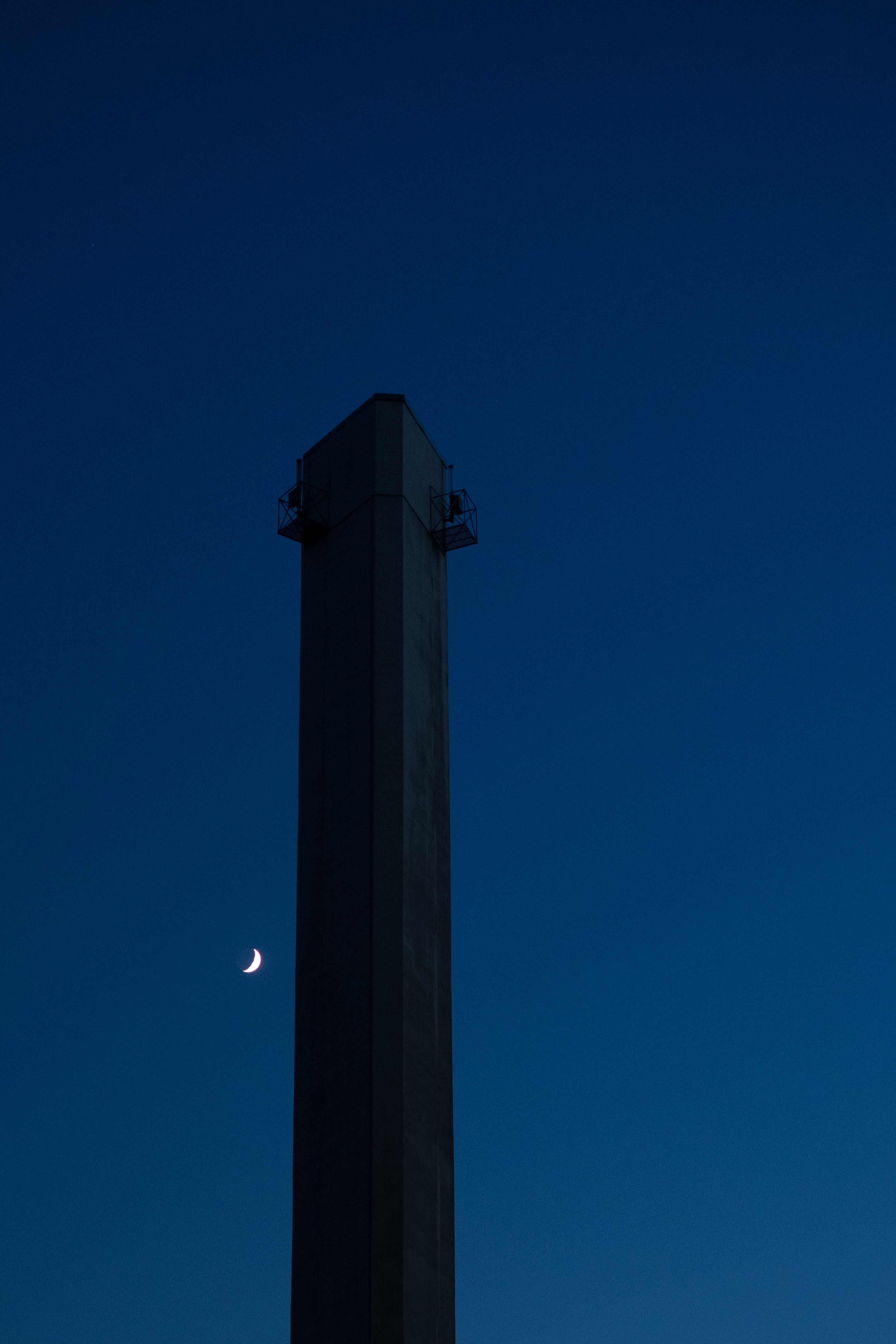 Crescent moon over a tower at Geneva