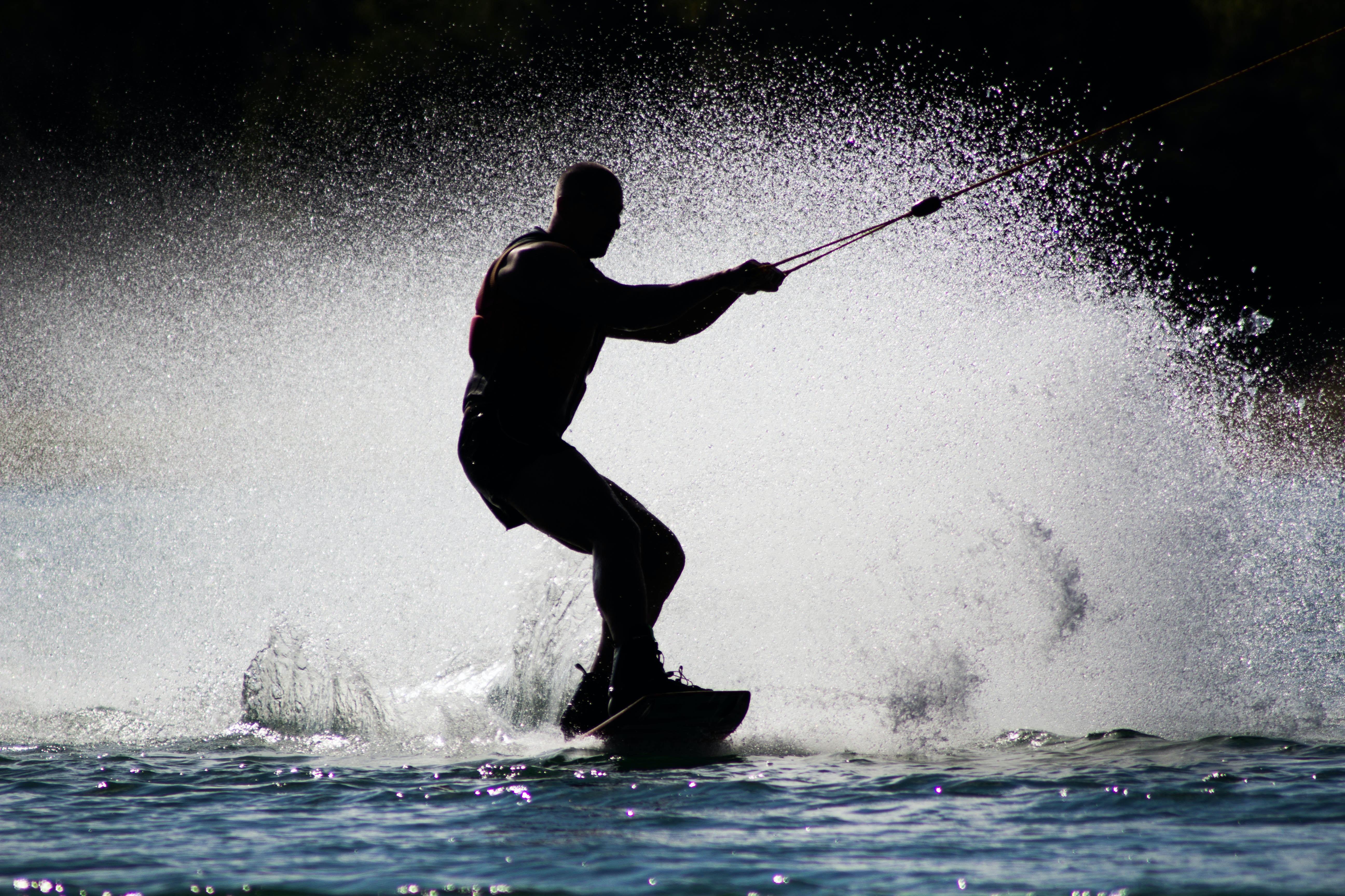 silhouette of man kite boarding
