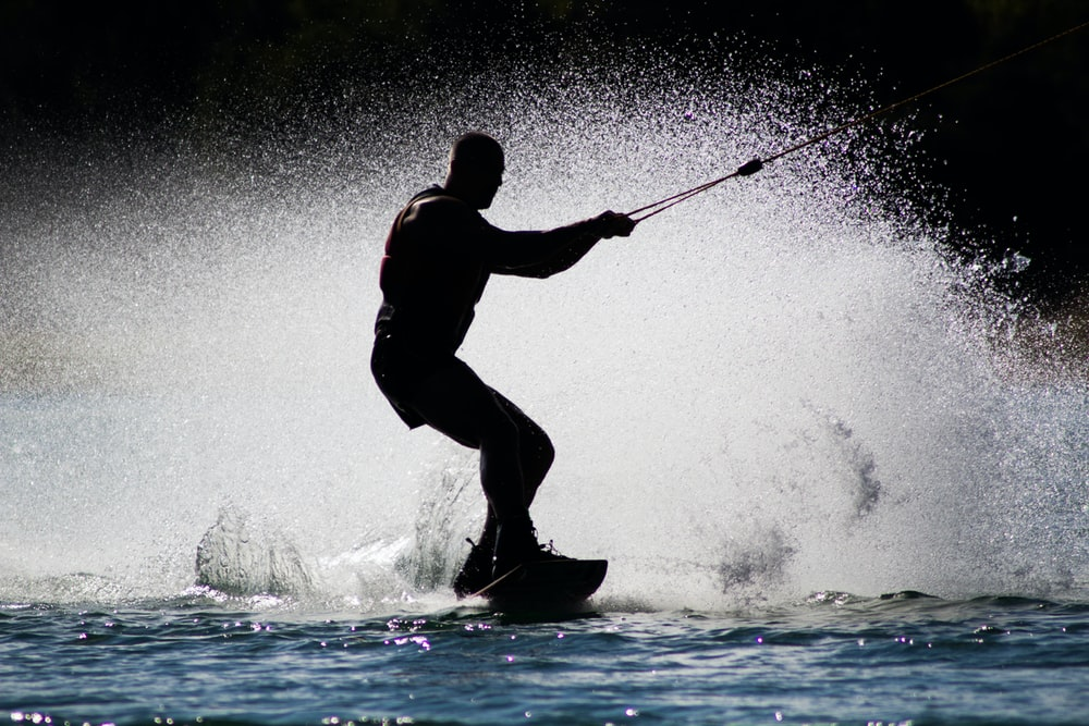silhouette of man kite boarding