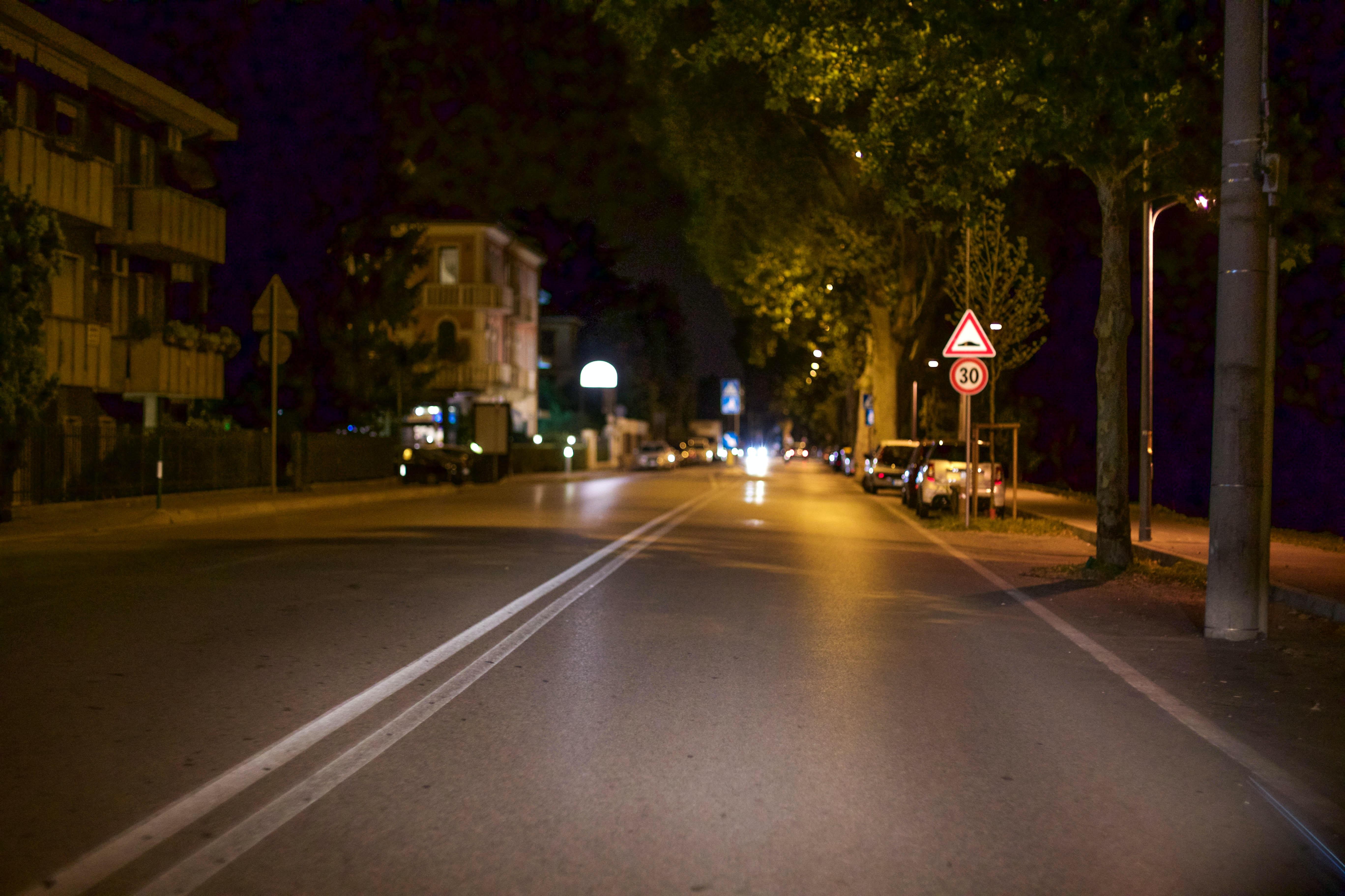 Empty city street of Padua glows at night