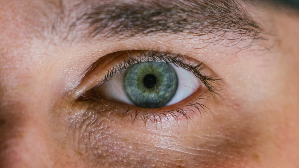 macro shot photography of person's right eye