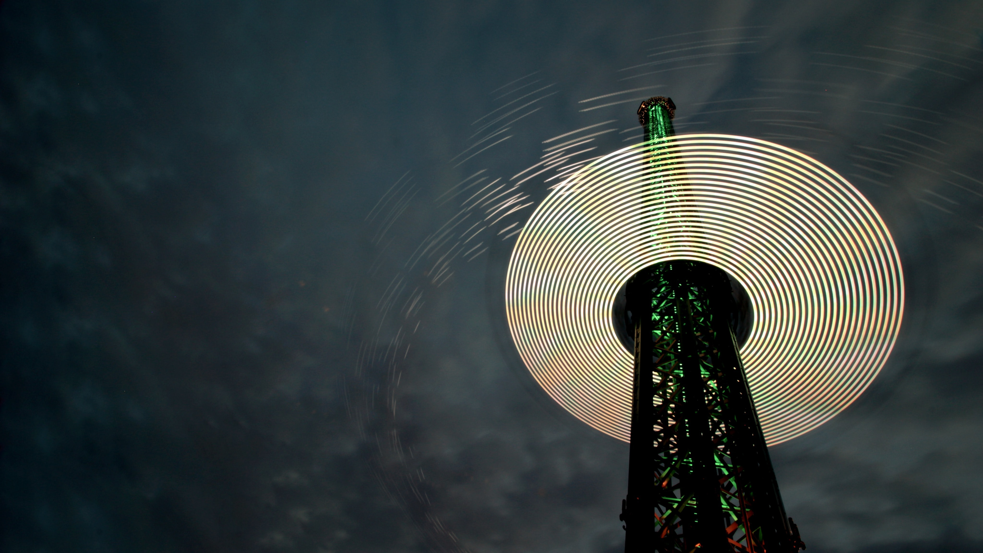 An image of the Prater Tower with a cloudy night sky as the backdrop