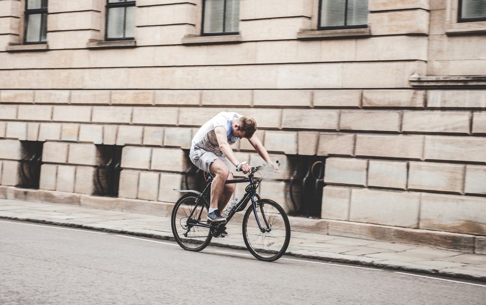 man cycling with bad posture