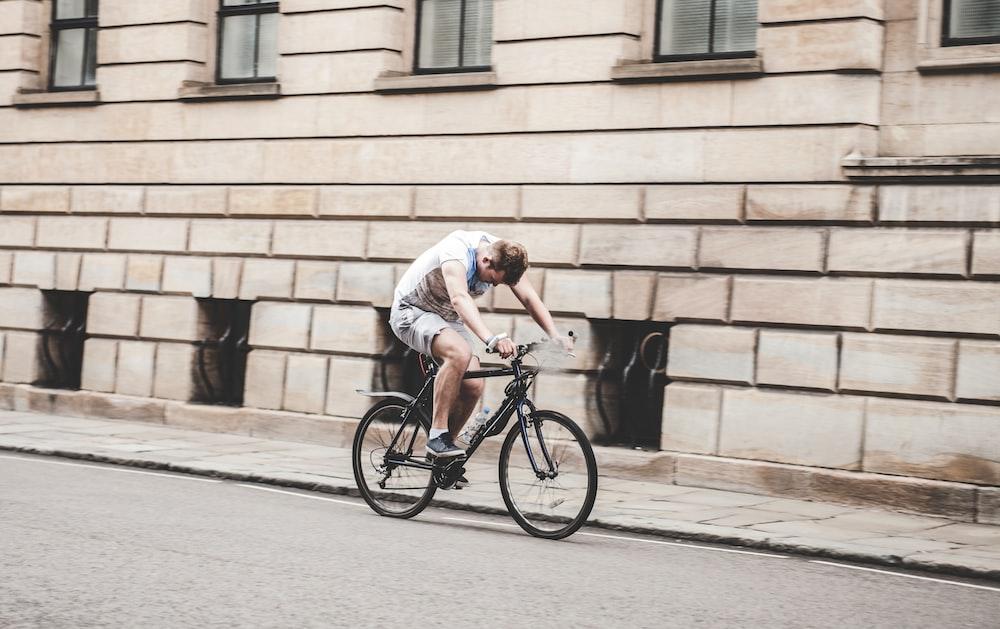 man wearing gray t-shirt and gray shorts cycling