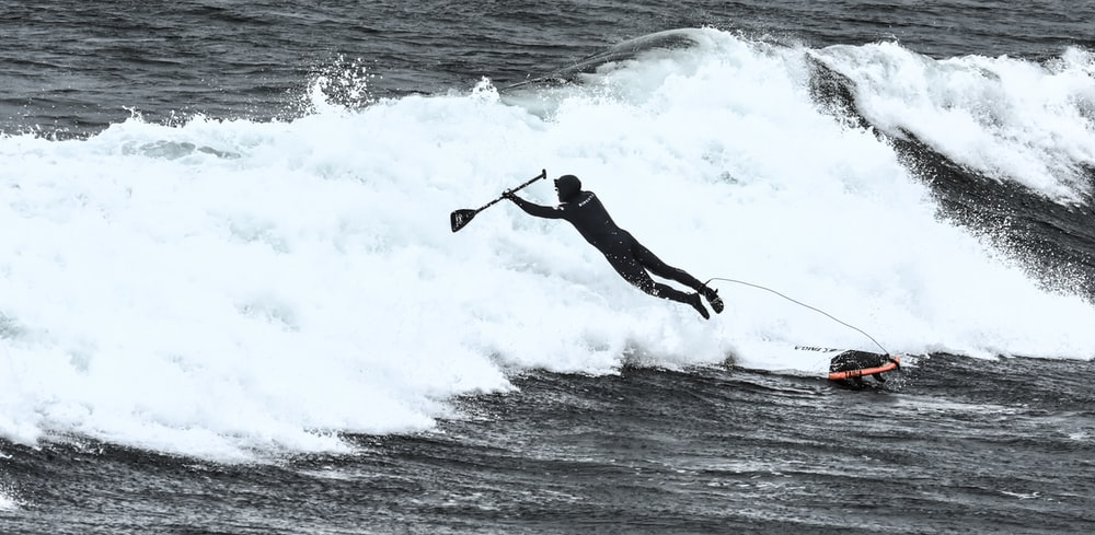 man riding surfboard