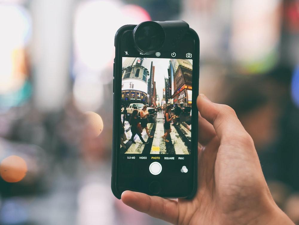 tilt-shift lens photography of smartphone captured fish-eye lens photograph photo of people crossing on pedestrian lane
