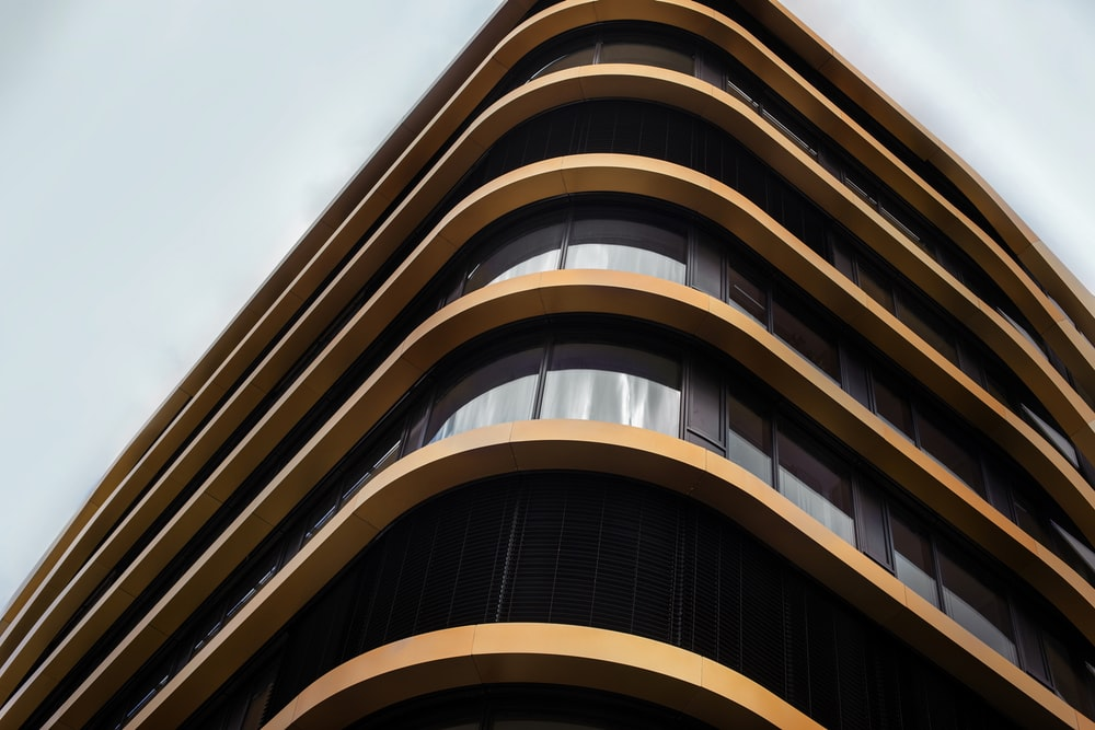 worm's eye view of brown glass building