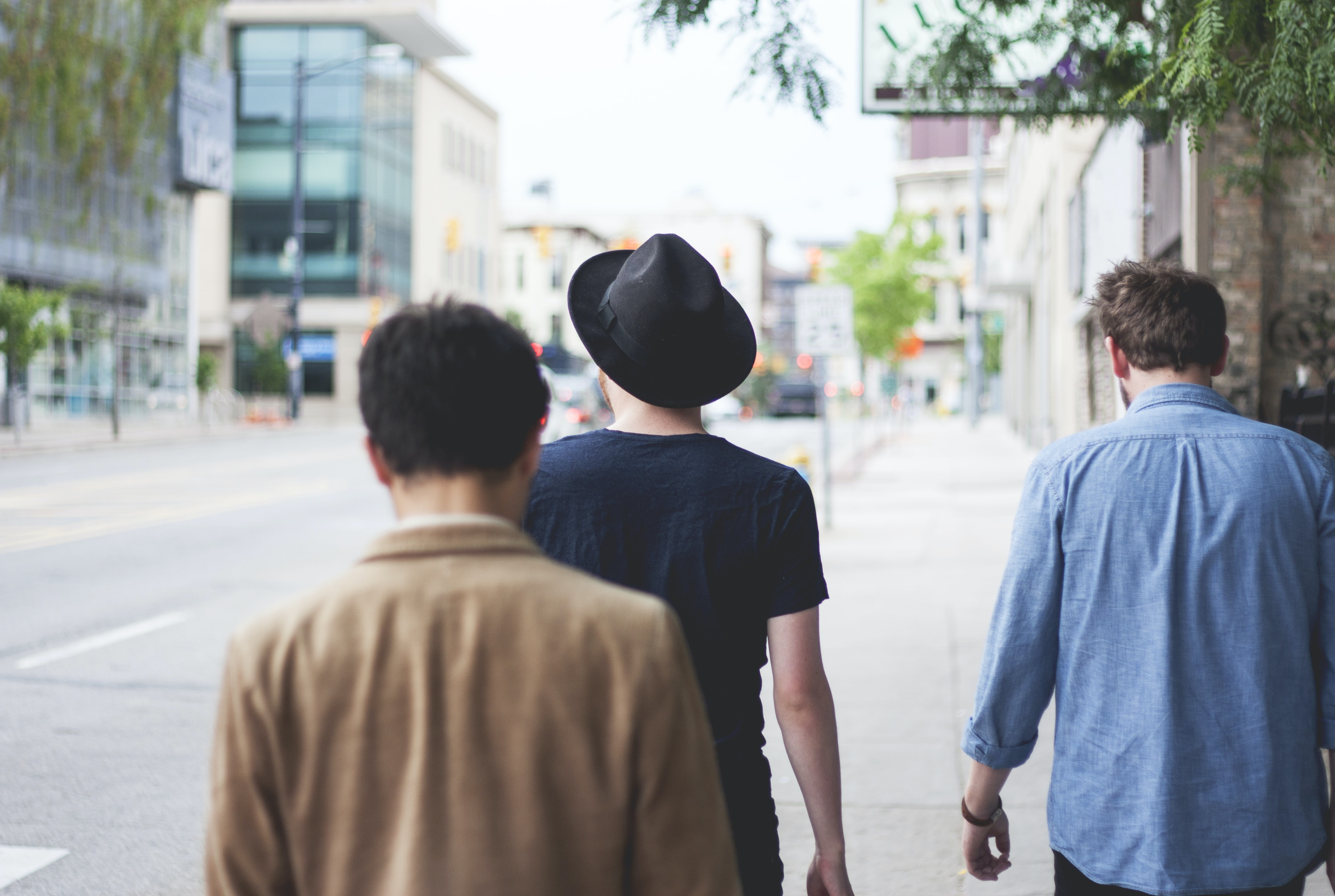 three men walking along the street