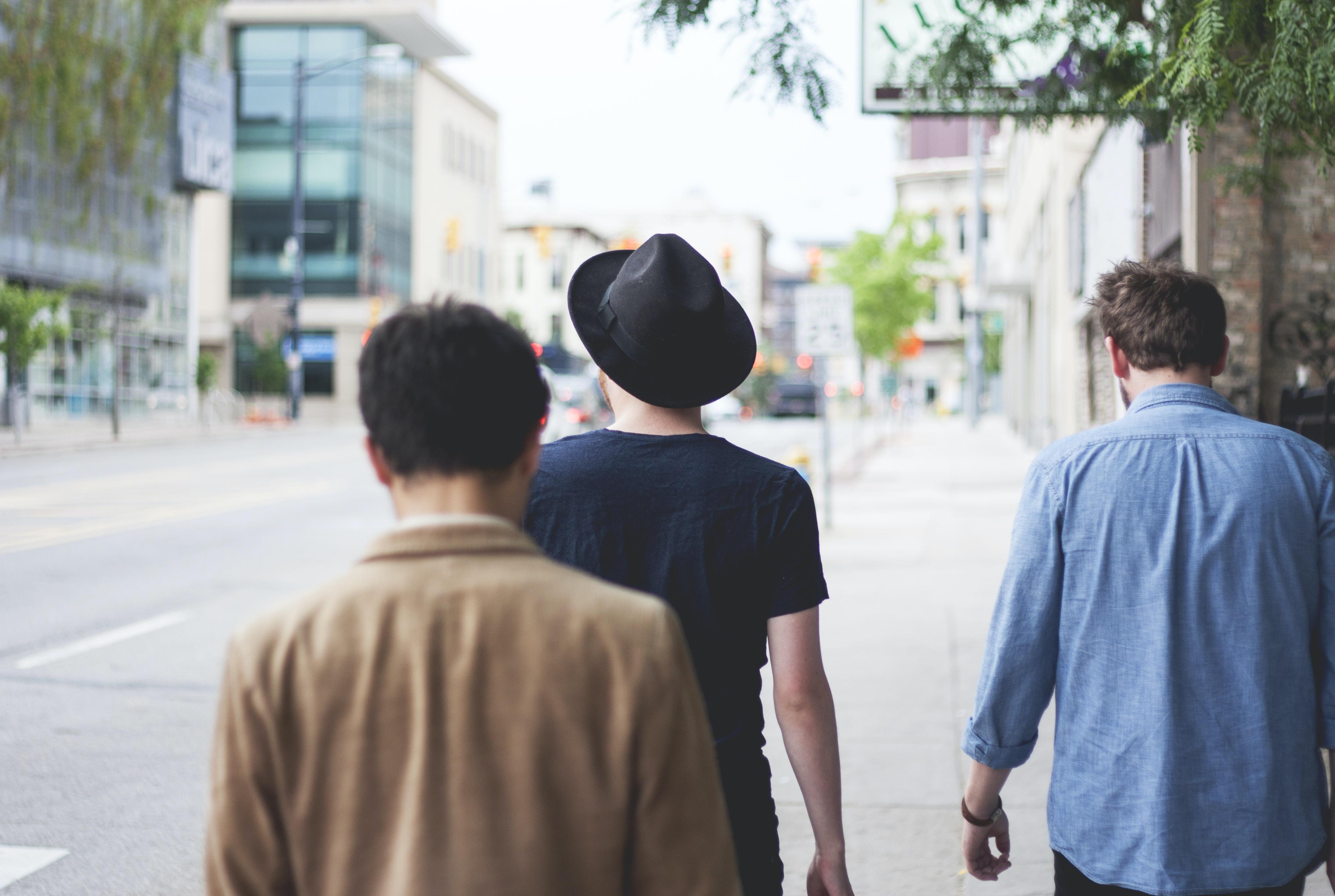 three men walking along the street