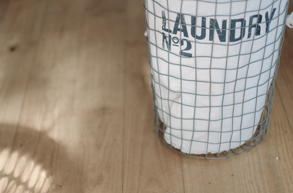 white laundry basket on wood floor