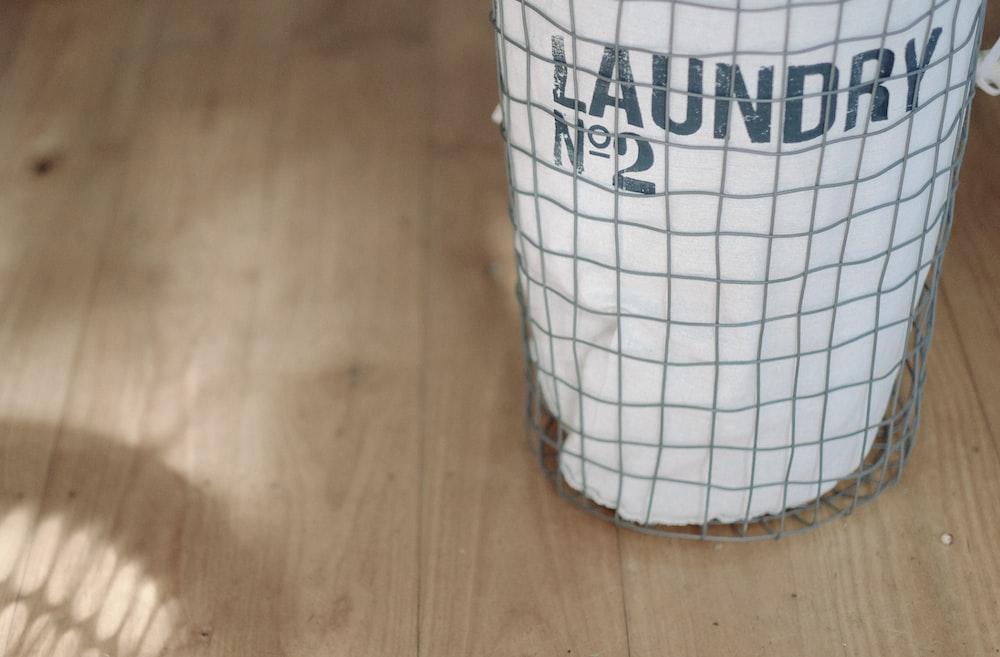 white laundry basket on wood floor