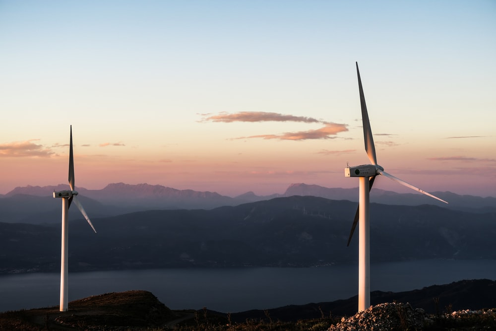two white wind turbines