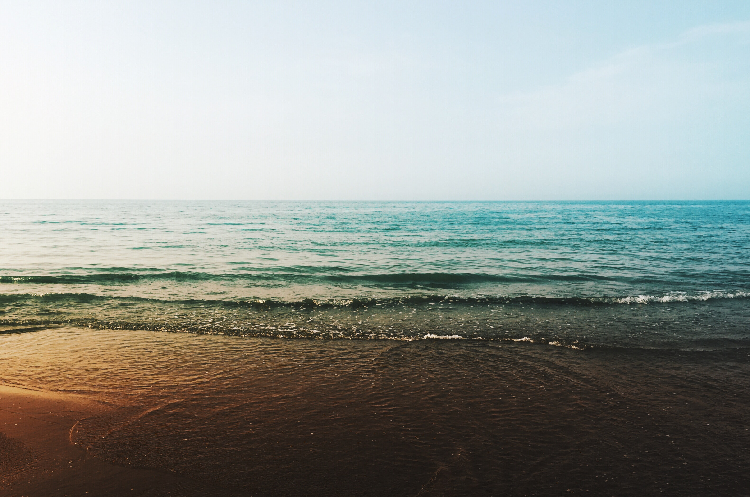 The sea and beach during golden hour in Chaboksar