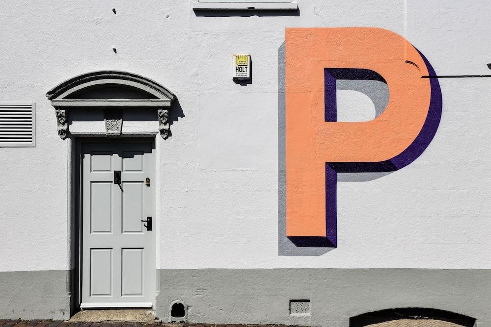 P painted on concrete building