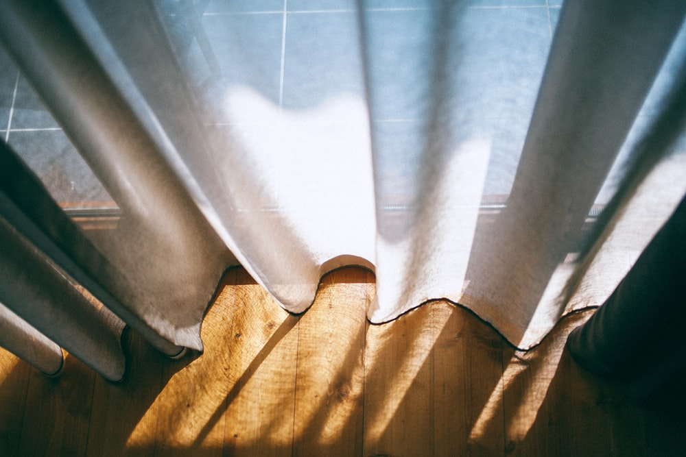 close up photo of white window curtain