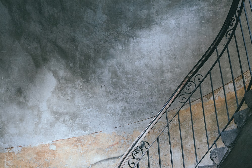 grey metal handrail on staircase