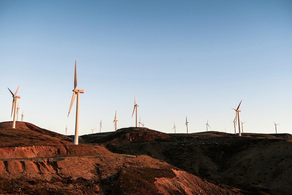 white wind turbines during daytime
