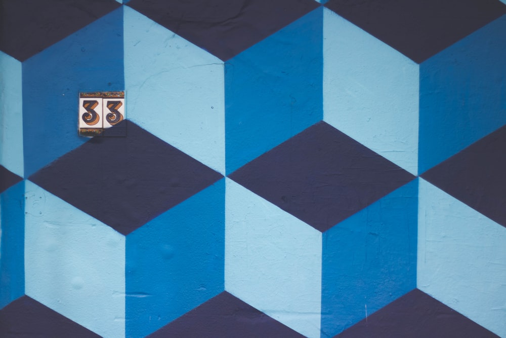 Geometric Blue Abstract Cubic Art Design Mural Over Number 33 Tile Sign In Brighton