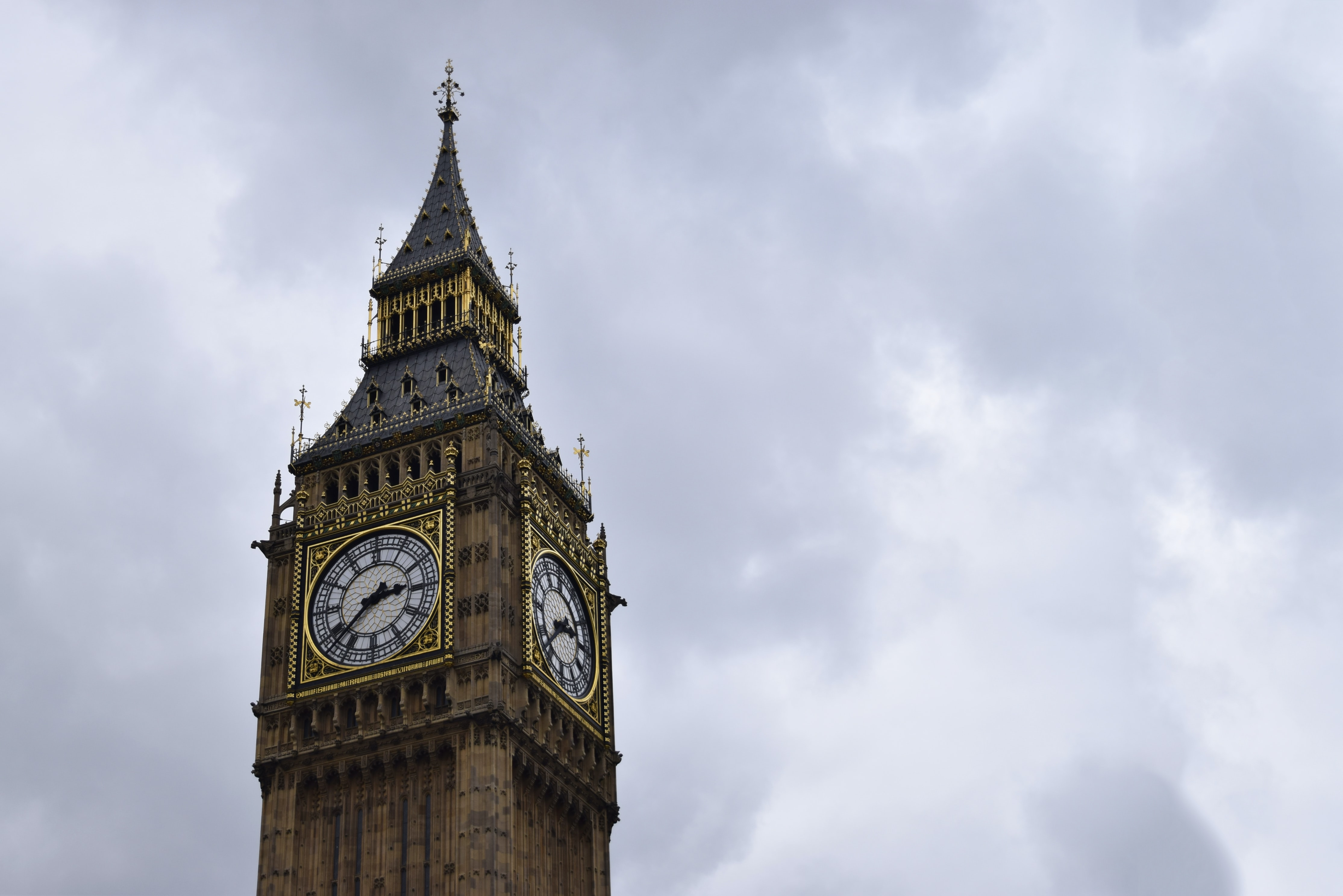 The Elizabeth Tower with the Big Ben bell in London against a cloudy sky
