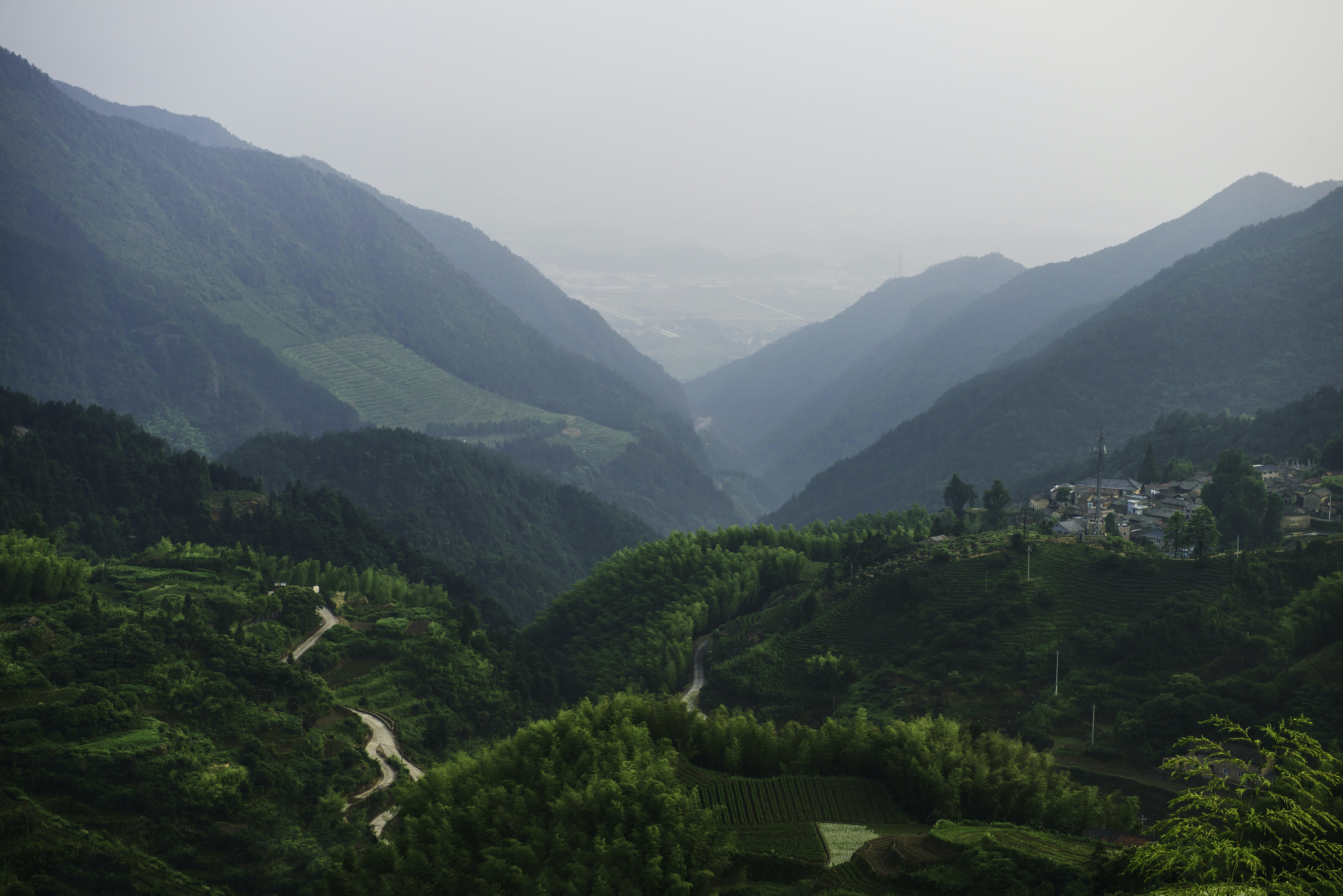 A village on a green hill overlooking a valley