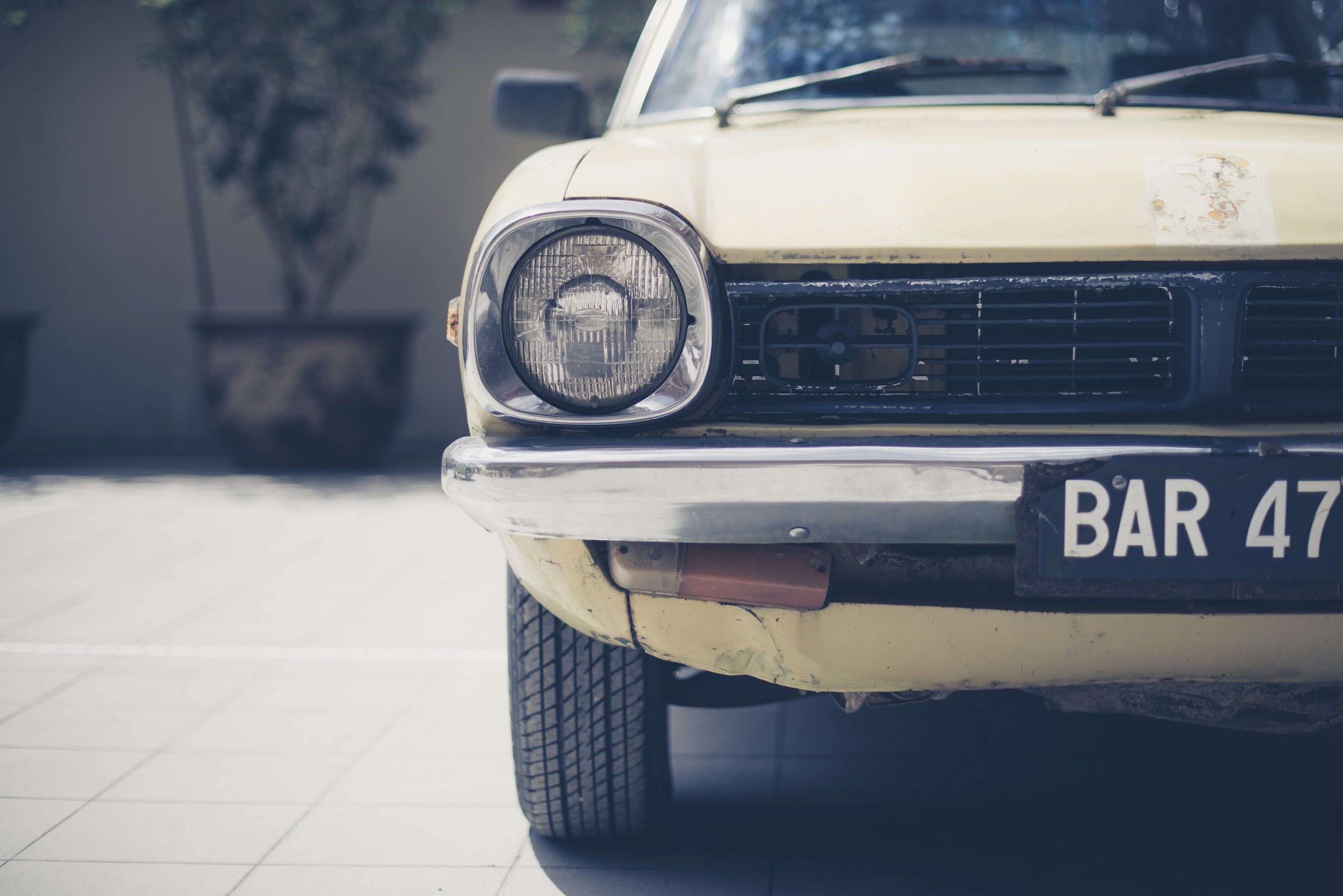 Retro white car with stylish headlight and grille
