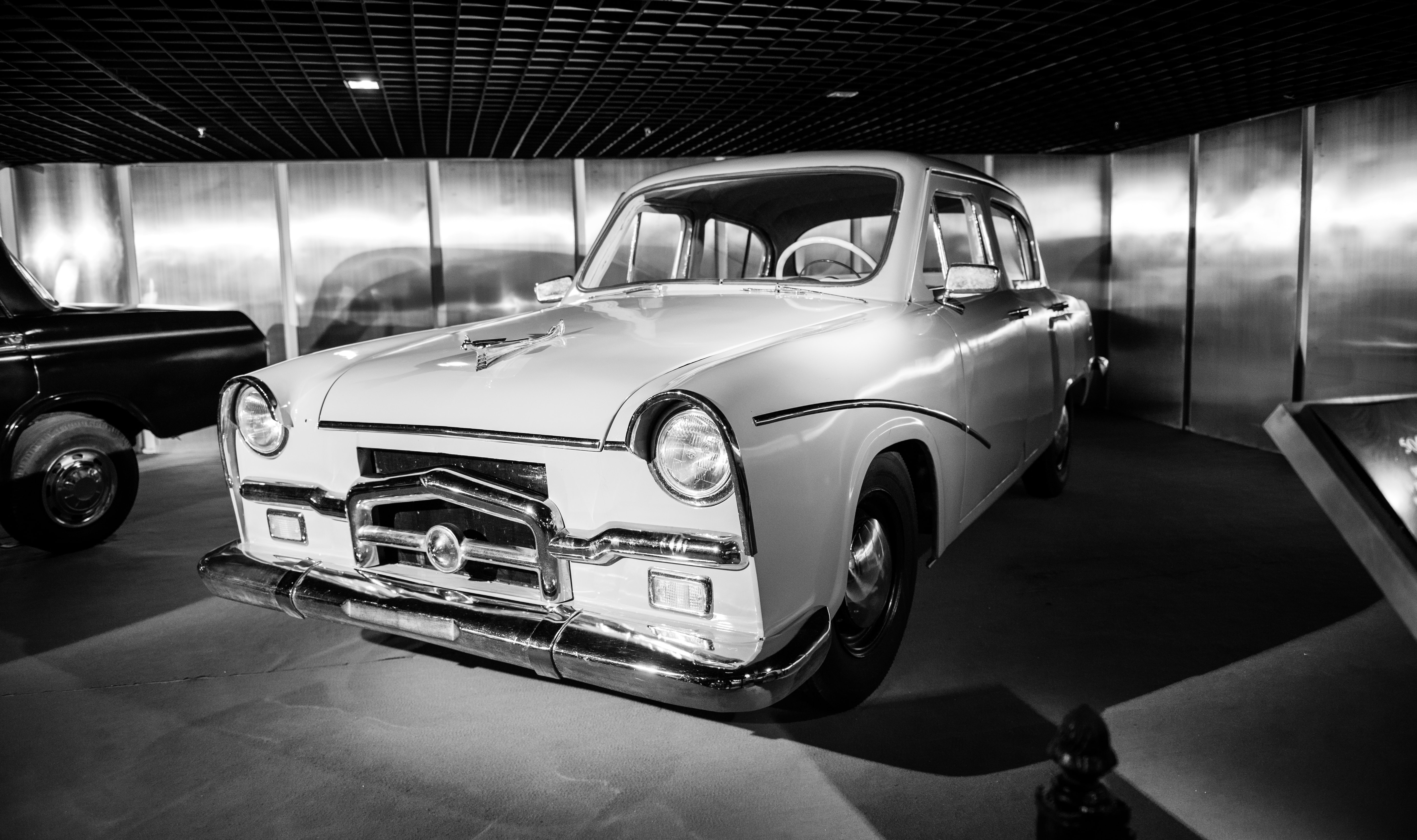 grayscale photography of classic coupe