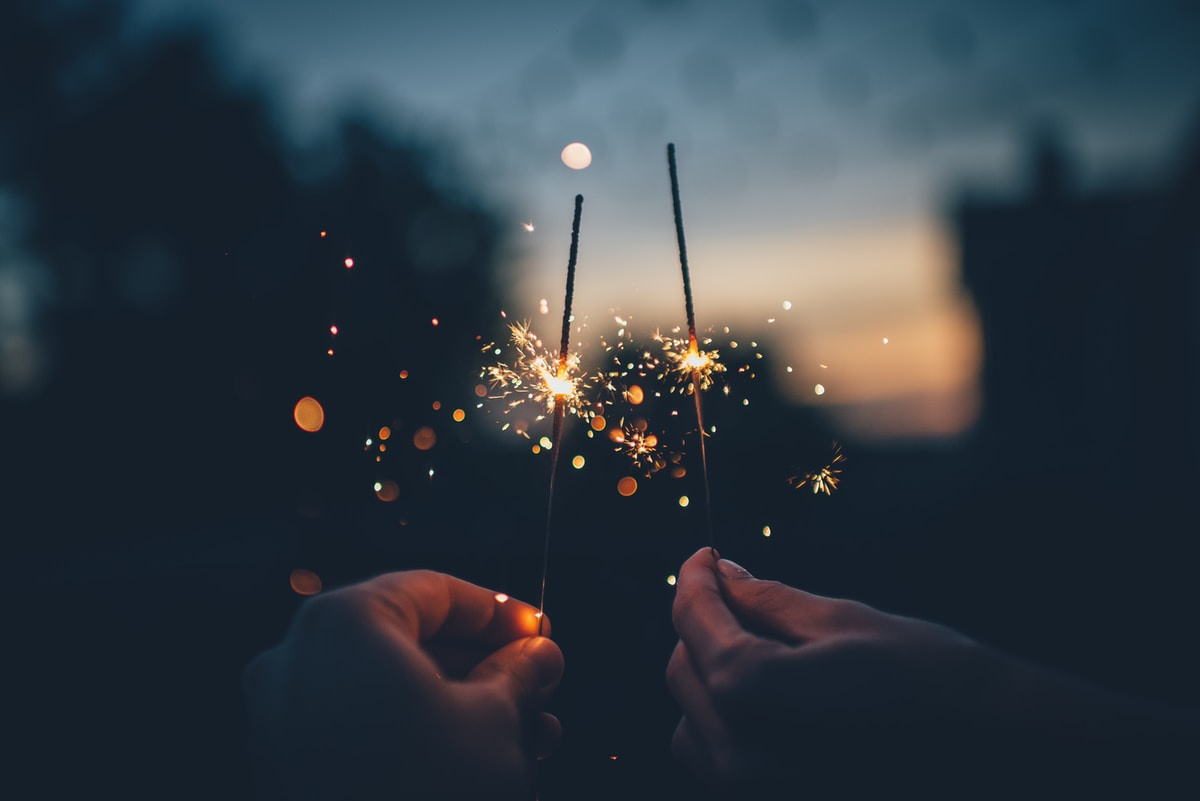 what are you looking for allegra salvoni coach allegra salvoni two hands holding lit sparklers