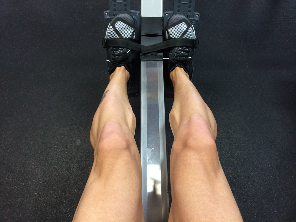 person sitting on rowing machine