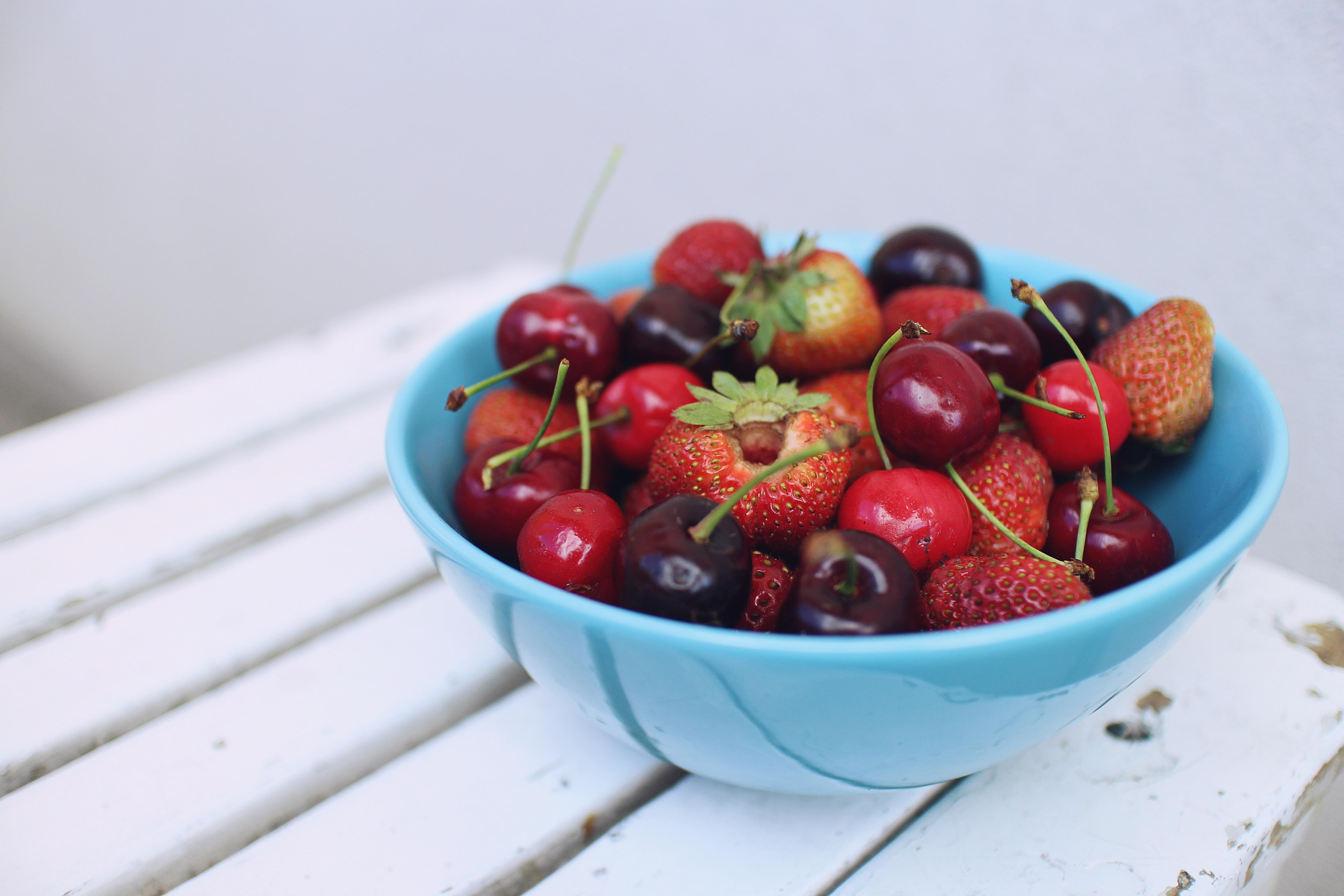 Bowl of fresh cherries, strawberries, and fruit
