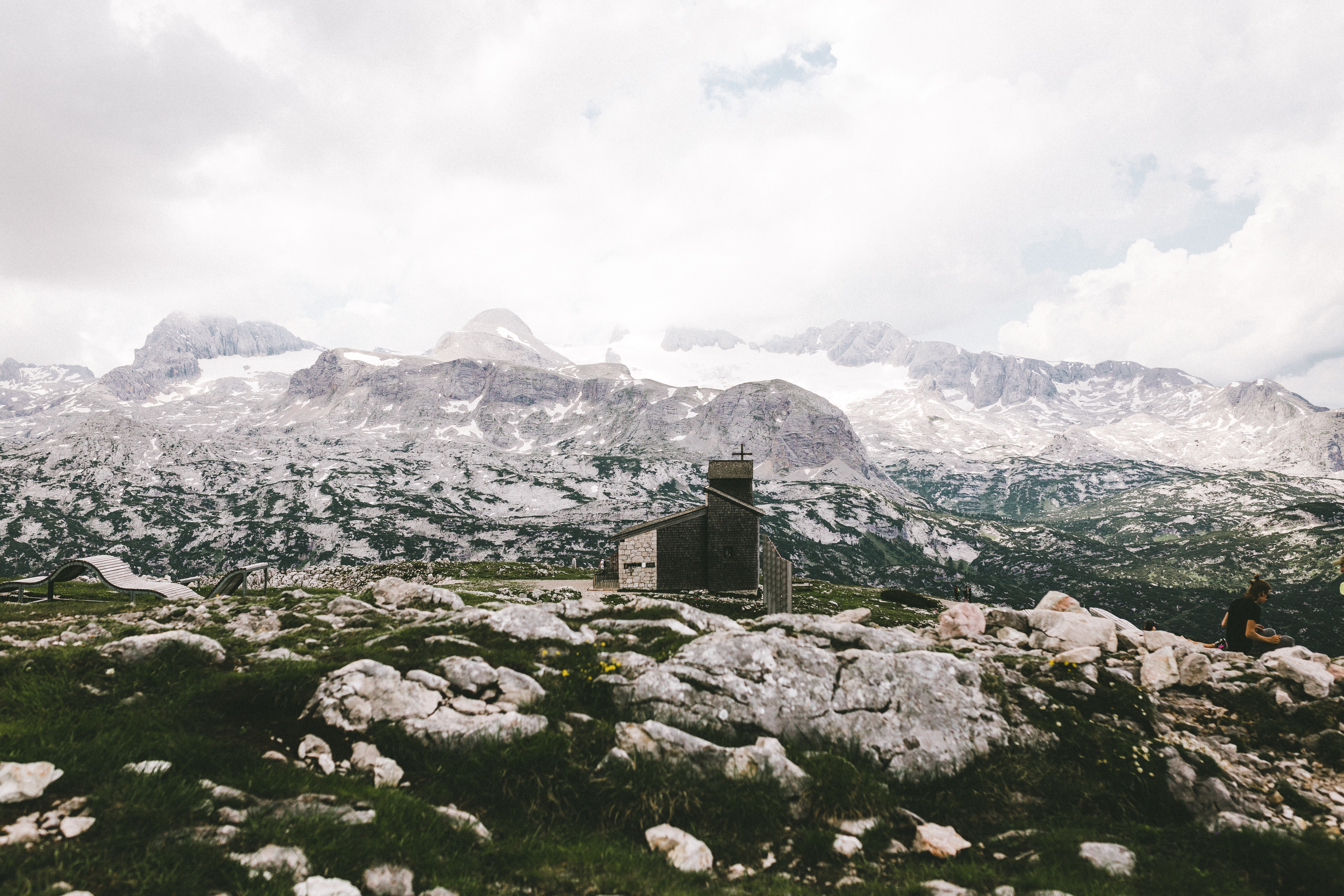 Grassy Dachstein Mountains surrounded by rock and snowy