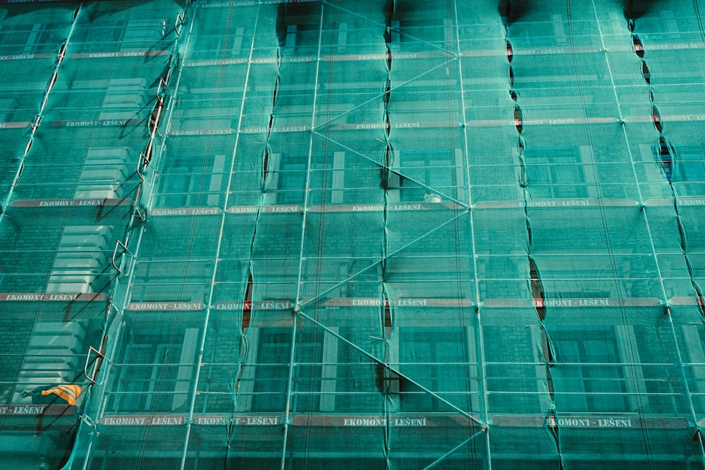 scaffolding covered by green net