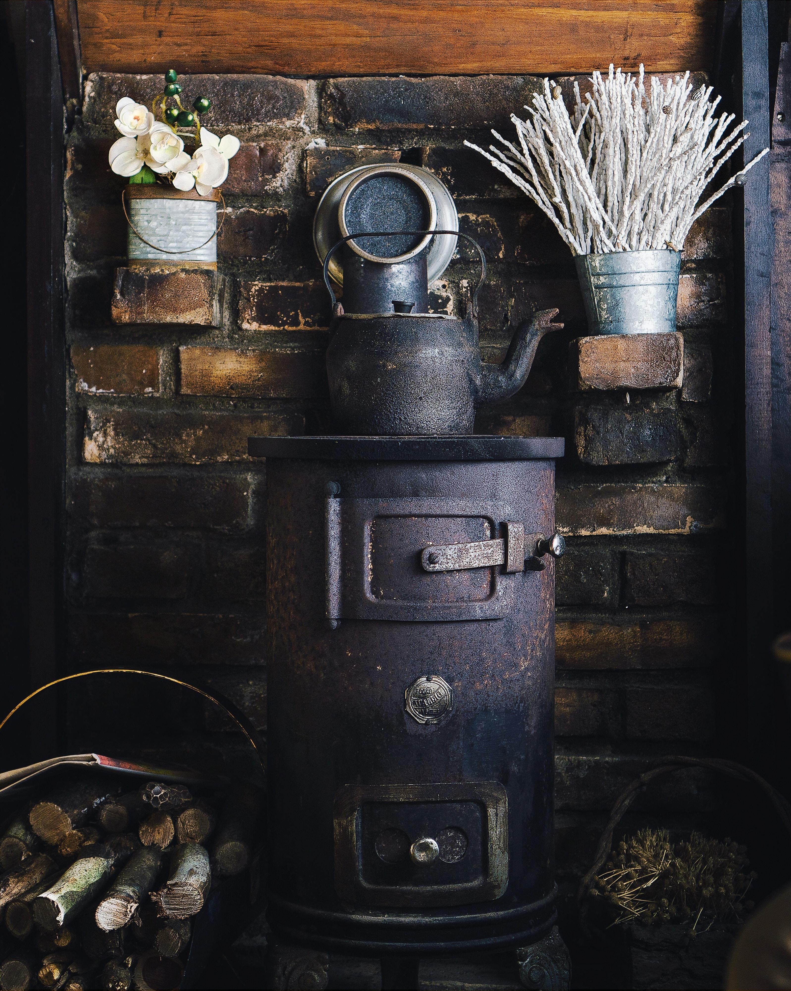 cast-iron teapot on wood burner