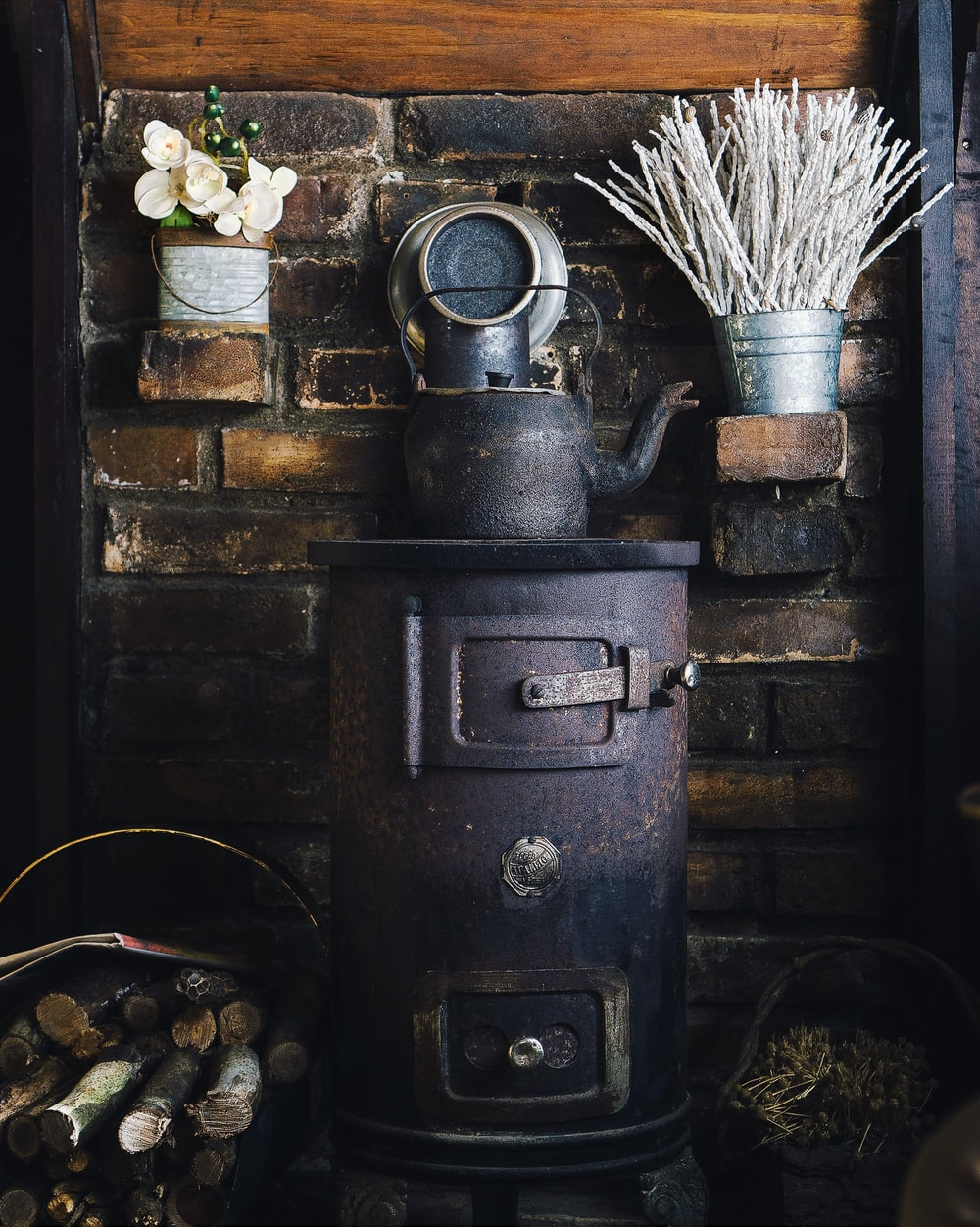 cast-iron teapot on wood burner