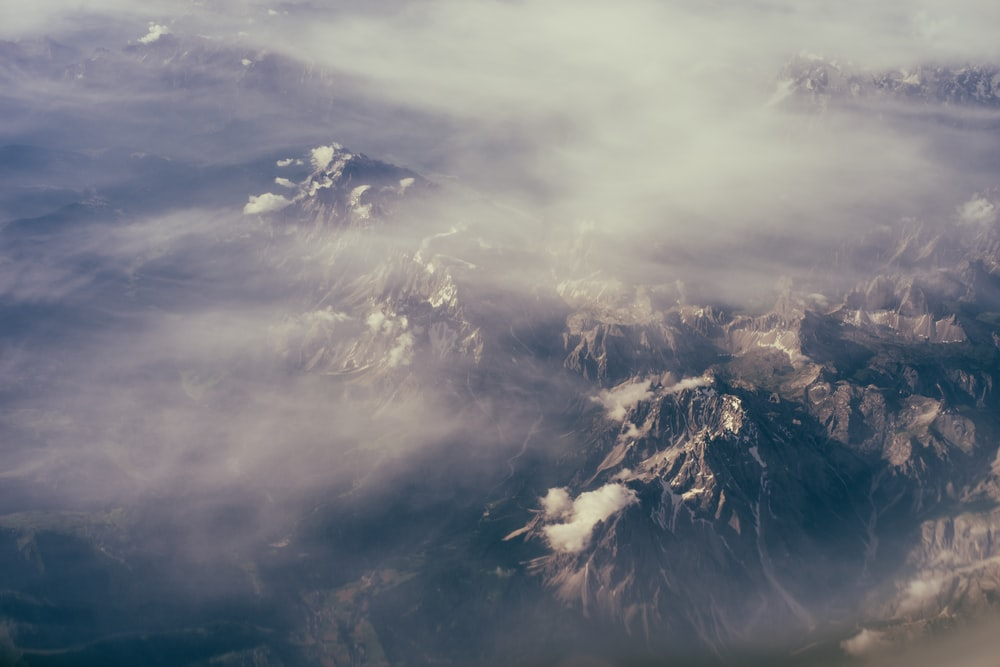 top view of mountain under white clouds