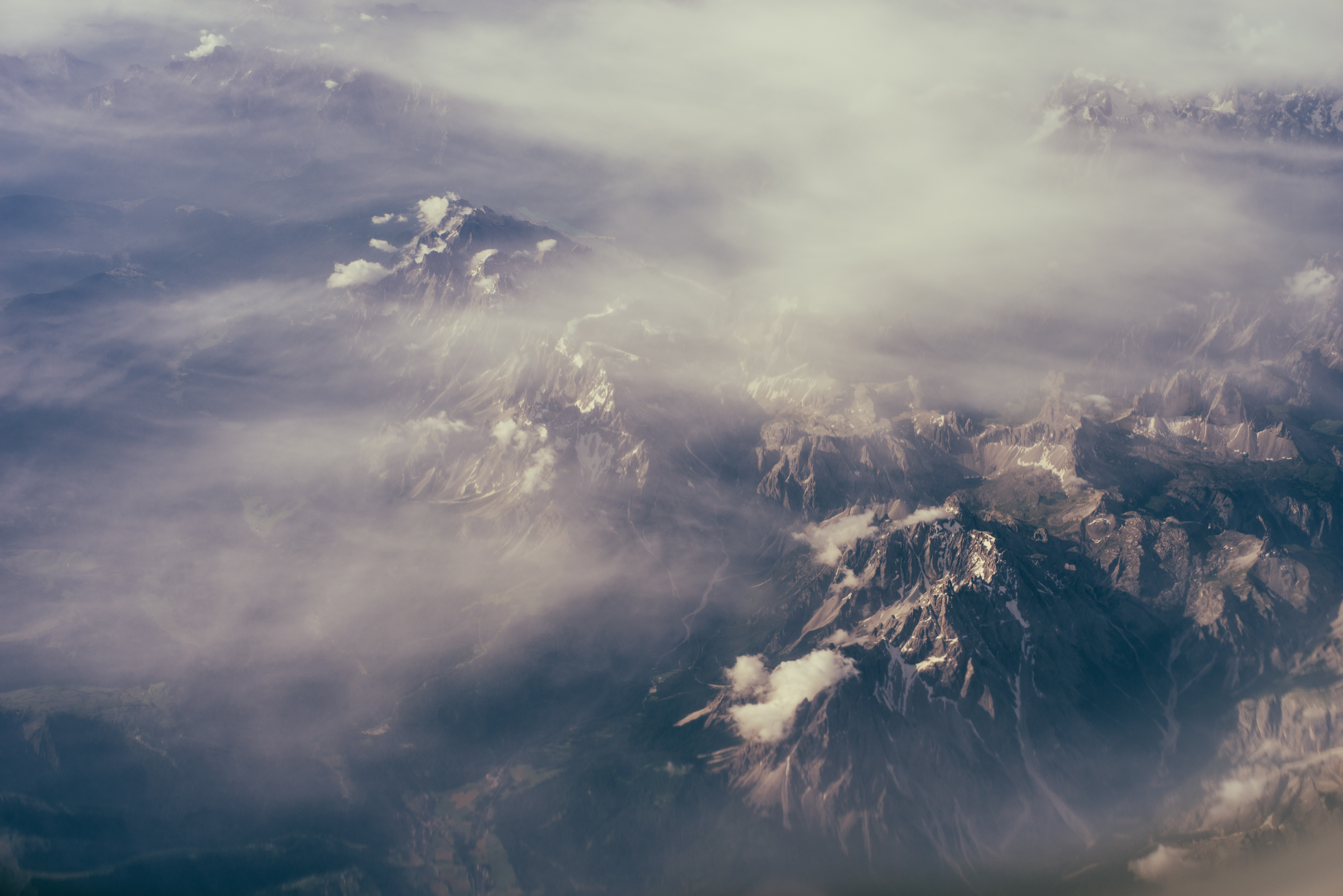 Fog covers rocky peaks and valleys of a rocky mountainscape