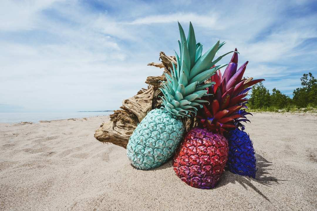 painted pineapples on the beach photo