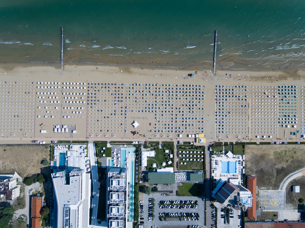 bird's eye photography of buildings near body of water